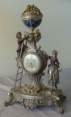 Spectacular antique Viennese silver and jewelled clock of young couple picking fruit from a tree. -