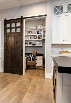 Brilliant idea- small office just off the kitchen Timber Frame Home with Farmhouse-Inspired Interiors
