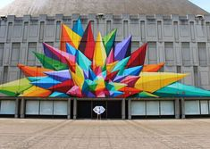 The street art and murals of artist Okuda San Miguel drip with color and burst with energy, until they are no longer held on a brick wall, but spilling out into real life, in three-dimensional form. The Madrid-based artist uses a pop surrealist style to create large scale murals that transform p