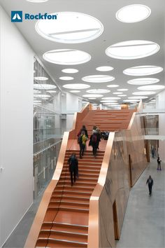 A new space for the Faculty of Technology was built at the University of Southern Denmark in 2015. The vision for the building was to create a connection to the existing buildings on campus. Rockfon® Mono® Acoustic is the first thing that you see when you enter the atrium. The beautiful round windows and the white ceiling lifts completely without joints complementing the copper staircase.   #schooldesignarchitecture #classroom #education #acousticceiling #acousticpanels… Round Windows, Acoustic Design, Acoustic Panels, White Ceiling, Noise Reduction, Atrium, Ceiling Design, School Design, Denmark