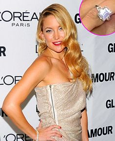 Kate Hudson's engagement ring is a platinum-set ring with an emerald cut diamond