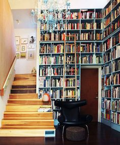 A bookcase with a ladder.  Drool!  From bookliciousblog.com 's Bookcase Wednesday