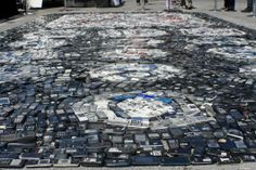 Seattle-based photographer and activist Chris Jordan uses visual art to get people thinking about consumerism. This piece in Melbourne, Australia uses 7,000 old mobile phones to question consumer waste- this is only 1/3 of Melbourne's daily  cell phone waste!