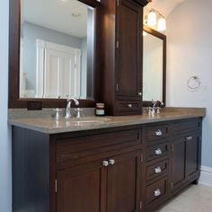 Traditional Bathroom Design, love the center cabinet