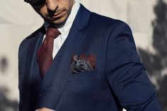 Navy suit & white shirt with soft red & grey tie and pocket square