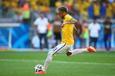 Neymar Photos Photos - Neymar of Brazil takes a penalty kick during the shootout of the 2014 FIFA World Cup Brazil round of 16 match between Brazil and Chile at Estadio Mineirao on June 28, 2014 in Belo Horizonte, Brazil. - Brazil v Chile: Round of 16 - 2014 FIFA World Cup Brazil