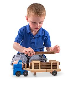 This wooden big rig is up to the big job of hauling logs from the forest to the lumberyard!  Five freshly sawn logs are held in place by an easy-release security strap to prevent the load from shifting on the open road. A great toy for the development of language, fine motor and imaginative play skills.