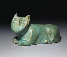 A Turquoise-Glazed Cat Weight  Probably Nishapur, 12th Century