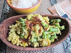 Balinese Chicken Lawar, SeriousEats (shallots, garlic, candlenuts/macadamia nuts, turmeric, green chilies, lemongrass, peppercorns, sesame seeds, cloves, nutmeg, green beans, oil, eggs, kaffir/lime leaves, ground chicken, stock, coconut milk, palm/brown sugar, grated coconut, shallots)