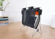 Love the idea of using a magazine rack in general for all the laptops by the couch.   A Magazine Rack for Your Devices — Design News
