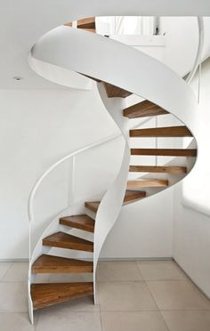 White spiral staircase with natural wooden treads