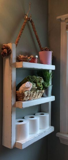 Hanging Wooden Ladder Shelf Our rustic 3-Tier ladder shelf is the perfect addition to any room. Add extra storage space to your bathroom, hang in the kitchen as a spice rack, add to the laundry room for supplies or display photos and family treasures in any room in your home. The shelf is made from 100% recycled wood. Each piece will be unique, knots, nail holes, small cracks and saw marks add to the rustic charm. Hung by 3/4 3 Strand Twisted Manila Rope which is the strongest of all n...