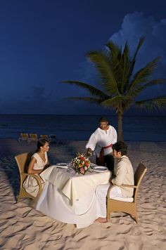 Romantic dinner on the beach at Ocean Blue & Sand resort in Punta Cana, Dominican Republic.