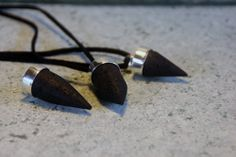 Genuine raw volcanic lava & silver pendulum pendants, for wearing, for dowsing, and because they look cool ! xxx lava is a raw, edgy, sexy kinda rock <3 @Lora Avalos-links.com