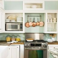 Luscious kitchens - mylusciouslife.com - Stainless oven. copper pots, wood counter, blue/green seafoam beadboard in kitchen