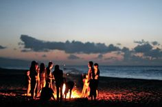 The beach bonfire creates a warm mood. The people, the center of interest, apply in the rule of thirds and the sunset/or sunrise creates pretty colors.