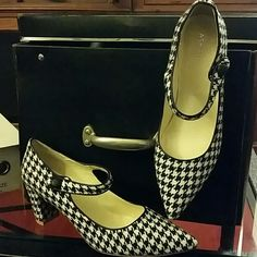 """Ashro Houndstooth Henderson Shoes NWOT Never worn. Classic hounsdtooth print on a Mary Jane style shoe is neatly finished with cord trim and a button. 2 3/4"""" covered heel. Still in the box that they came in. Beautiful pair of shoes for office wear or a night on the town.  **Price is Firm** Ashro Shoes Heels"""