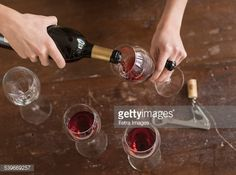 Stock Photo : USA, New Jersey, Elevated view of woman pouring red wine