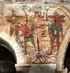 Yorkshire: Pickering Church - restored C15 wall paintings St Edmund not St Sebastian but equally uncomfortable