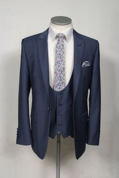 The newest collection to our hire ranges is this Steel blue wool & mohair slim fit lounge suit available from stock from july 2015 shown here with a scoop waistcoat and liberty print tie and hankie. Complete outfit available to hire for £159.50 #wedding #suit #groom #groomsuit #suithire #waistcoat #steelblue #weddingstyle #groomstyle