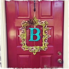 Front door welcome. Laser cut wood frame with moss and last name monogram.
