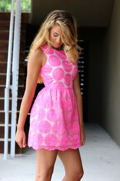 Perfect in pretty pink party dress.