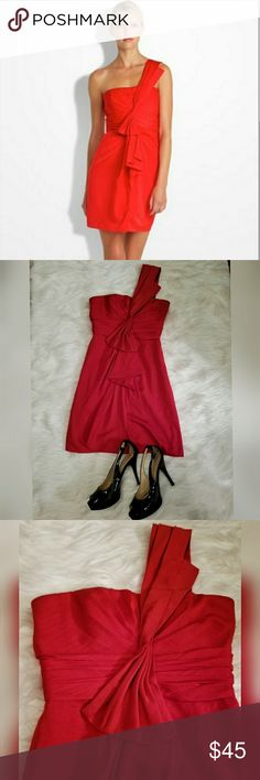 BCBG Red One Shoulder Party Cocktail Dress Sz 0 Just in time for the holidays! A very sweet and sexy dress in a bright tomato red. The color is most accurate in the model shot. Pretty ruching details give this a tailored classy look. Gently worn I could find no major flaws. BCBG Dresses Midi