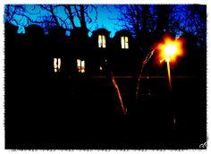 è calata la sera ...finestre e abbaini illuminati in Corso Umberto , Torino