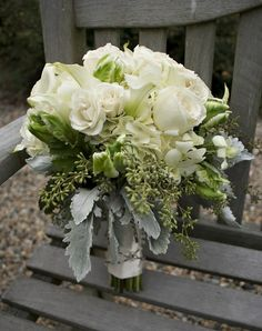 bouquet - this bouquet has roses and other white flowers we wouldn't use.   This is what a bouquet could look like with dusty miller and seeded euc.