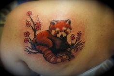 It's nice to see it as an actual tattoo although I doubt I would get it with all of the flowers and stuff... there is a special reason I would get a red panda tattoo.