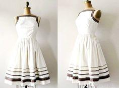 50s dress - http://www.etsy.com/listing/73605873/vintage-1950s-dress-latte-cream-50s?ref=hp_tt_yt