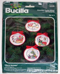 Four Round Peanuts Ornaments Cross-stitch Kit. I am SO making these