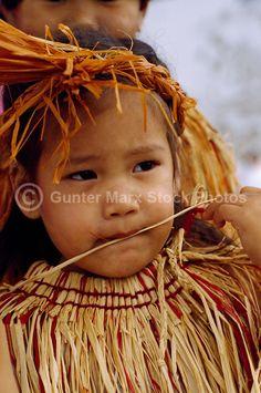 Portrait of Coast Salish Native American Indian Girl wearing Traditional Cedar Bark Costume at Powwow, BC, British Columbia, Canada