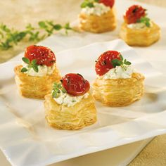 These delectable appetizers are so good they?ll be gone in a flash! Golden puff pastry cups are filled with a garlic & herb cheese spread that is topped with a scrumptious roasted tomato mixture. They?re so good you may want to double the recipe for your next party because they?ll be gone in a flash.