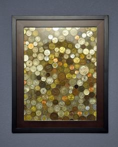 Foreign Coin Art~  Fantastic idea for displaying all the foreign coins you have from international vacations, and a great way to remember them every time you pass by!