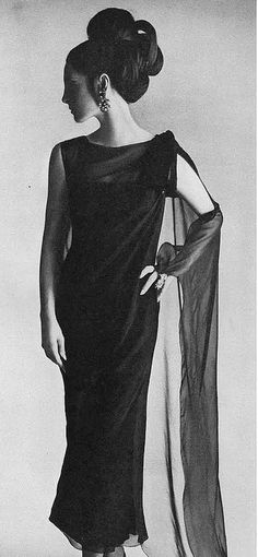 Mirella Pettini is wearing an ankle length black chiffon with sheer panel floats by Adele Simpson, photo by Irving Penn for Vogue 1965