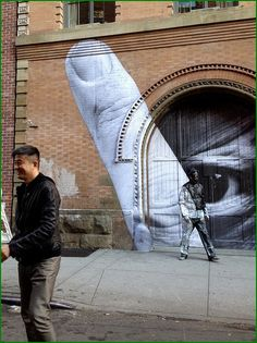 JR & Liu Bolin https://opsis.squarespace.com/art/16/6/2013-the-invisible-mans-gun-rack-performance