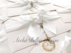 Christian wedding invitation - gold logo embossed and white linen, with rosary