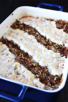 Crowd-Pleasing Sweet Potato Casserole - has both a pecan topping and a marshmallow topping for the best of both worlds! *Site also has video demonstration of this recipe!