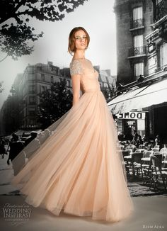 blush gown with crystal cap sleeves.