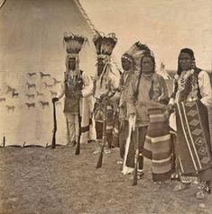 Blackfoot/Blackfeet Indian Tipis     Blackfoot/Blackfeet Indian photographed in front of his tipi in 1898.     1888 photo of a Blackfeet/Bl...