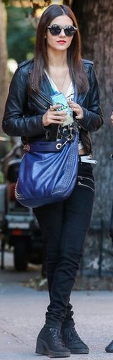 Blue studded handbag, black leather jacket, skinny zipper jeans