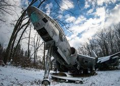 These eerie pictures show all that remains of a fleet of World War II fighter planes. The rotting planes lie derelict at an abandoned aeroplane graveyard in Ohio, amongst overgrown foliage and scrap metal. The haunting images were captured by 24-year-old photographer, Jonny Joo, who has made a name for himself by venturing into long-abandoned places. Plane Photography, World War Ii, Abandoned Cars, Abandoned Places, Haunted Places, Abandoned Buildings, Wwii, Fighter Aircraft, Fighter Jets