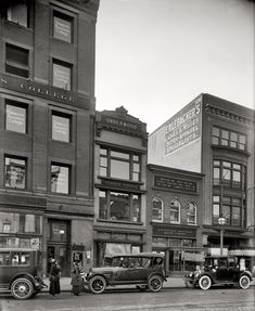 """Viewed in full size you can see that the store on the far right is a women's clothing store and the one next to it is a travel agency with all the steamship line names on the widow. Love this. Washington, D.C., circa 1918. Another thrilling installment of """"Emergency Fleet Corporation, building exterior."""" At center is the Underwood typewriter office at 1206 F Street N.W. Harris & Ewing Collection glass negative."""