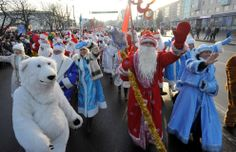 Belarus: Men wearing costumes of Ded Moroz (Grandfather Frost), the Santa Claus in Russia, Belarus and Ukraine, and women wearing costumes of Snegurochka (Snow Maiden), the traditional companion of Ded Moroz, march during their parade in Minsk on December 25, 2013. (Viktor Drachev/AFP/Getty Images)