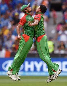 Joined at the chest: Taskin Ahmed and Mashrafe Mortaza celebrate Ajinkya Rahane's wicket, Bangladesh v India, World Cup 2015, 2nd quarter-final, Melbourne, March 19, 2015