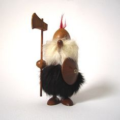 A burly viking for your collection. This small warrior is armed with a shield and hatchet, his helmet lacks horns but it has a bright red
