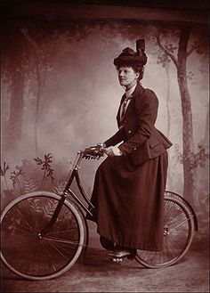 """Photographer unknown, A lady wearing """"proper attire"""" astride her bicycle, Circa 1898. Cabinet card, Collection of Lorne Shields."""