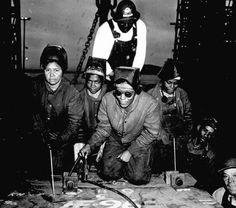 Welders Alivia Scott, Hattie Carpenter, and Flossie Burtos are about to weld their first piece of steel on the shipSS George Washington Carverat Kaiser Shipyards in Richmond, California. 1943