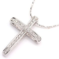 FC JORY White Gold Plated Rhinestone Cross Cubic Zirconia Pendant Necklace Silver. The cross is about 0.8x1.06inch. The chain is about 17.75 inch with extending chain. One-Day Shipping from Fulfillment by Amazon. The same style is also available in rose gold.